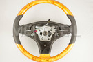 Leather Black Steering Wheel With Poplar Trims for SL-Class R230 including Steering Wheel (1 pc.), Gearshift Paddels Set (1 pc.) in Steering Wheels.